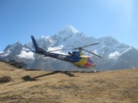Heli with Mt. Thamserku at background