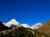 View of Manaslu from lho and lho monastery gate at the background